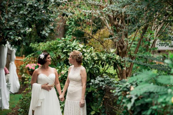 same sex brides holding hands
