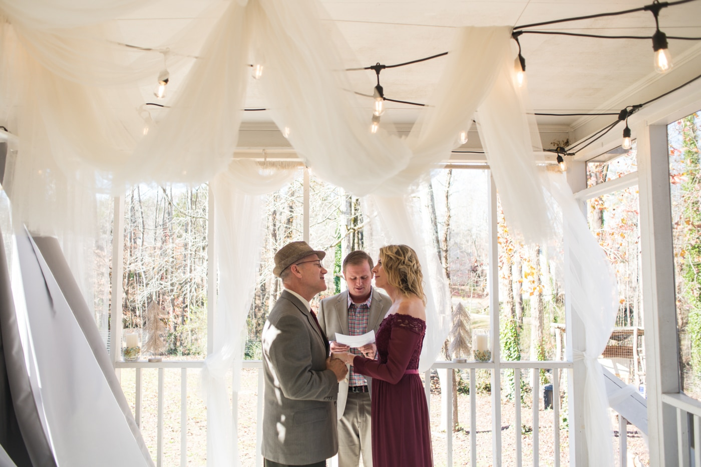 at-home elopement wedding ceremony with couple and officiant