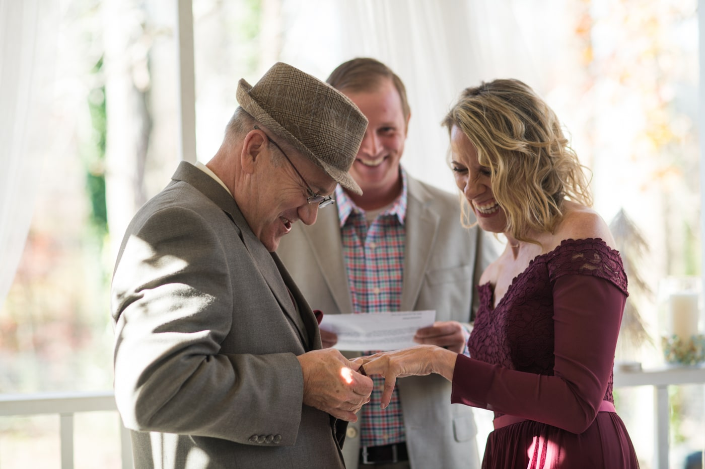 bride and groom exchange rings during at-home elopement
