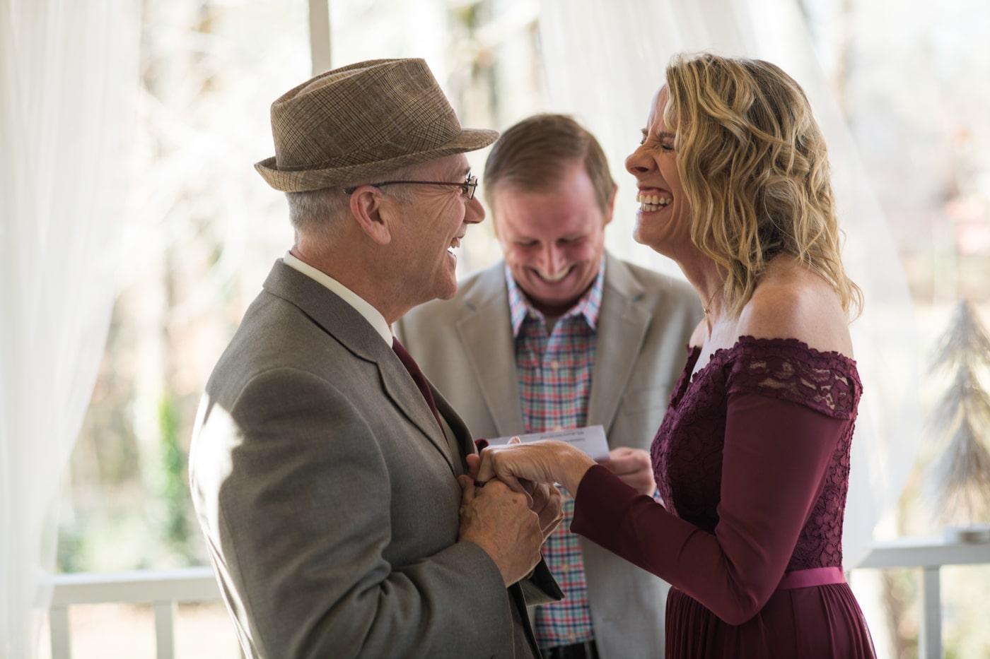 bride laughs during elopement at home in Atlanta GA