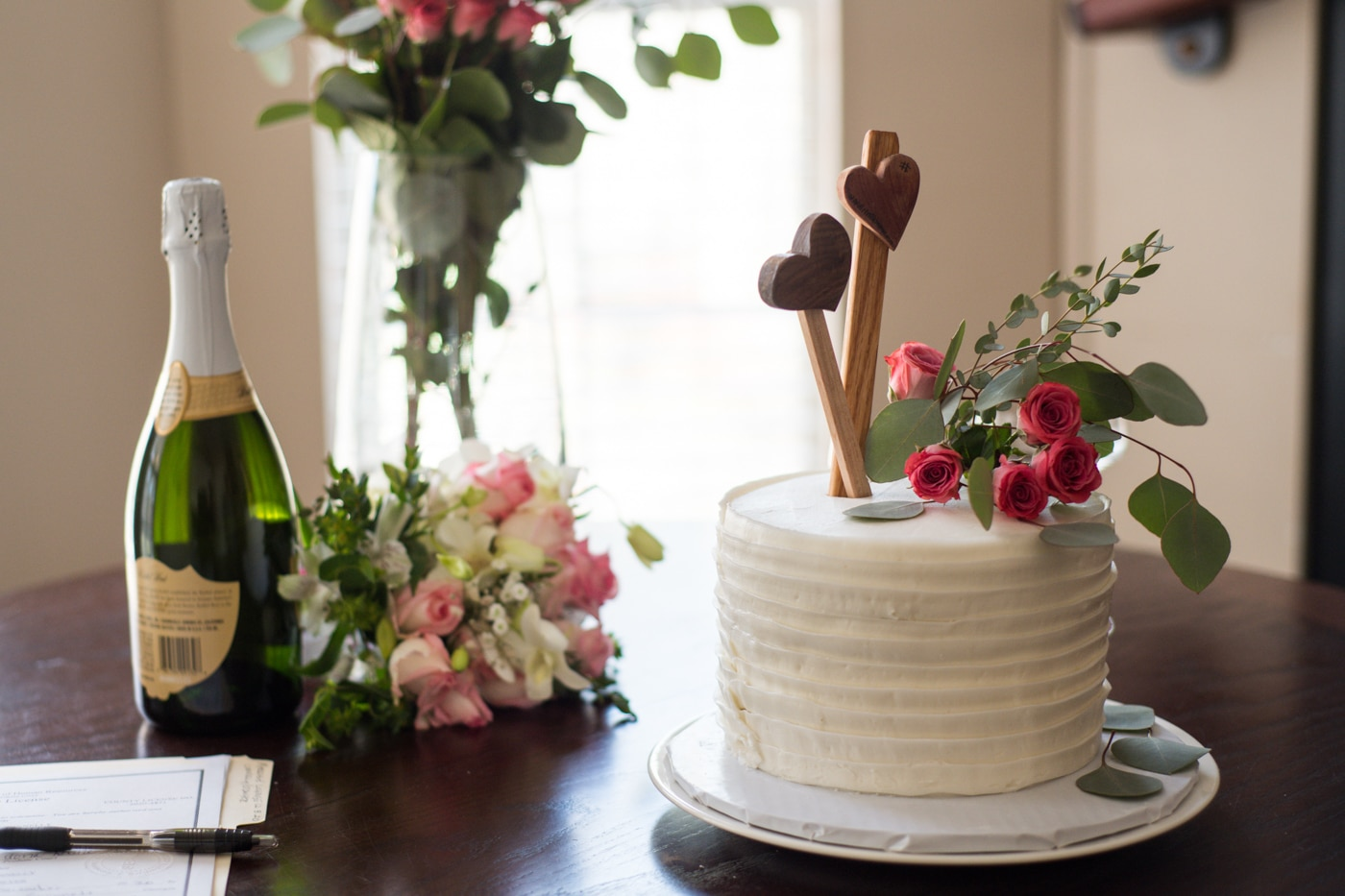 wedding cake and champagne for at-home elopement