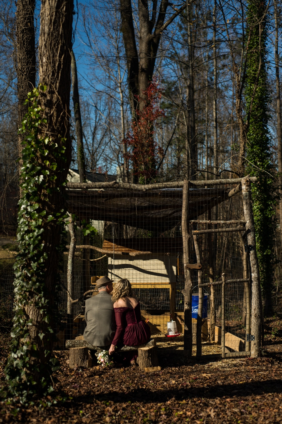 Atlanta couple sits on bench by chicken coop