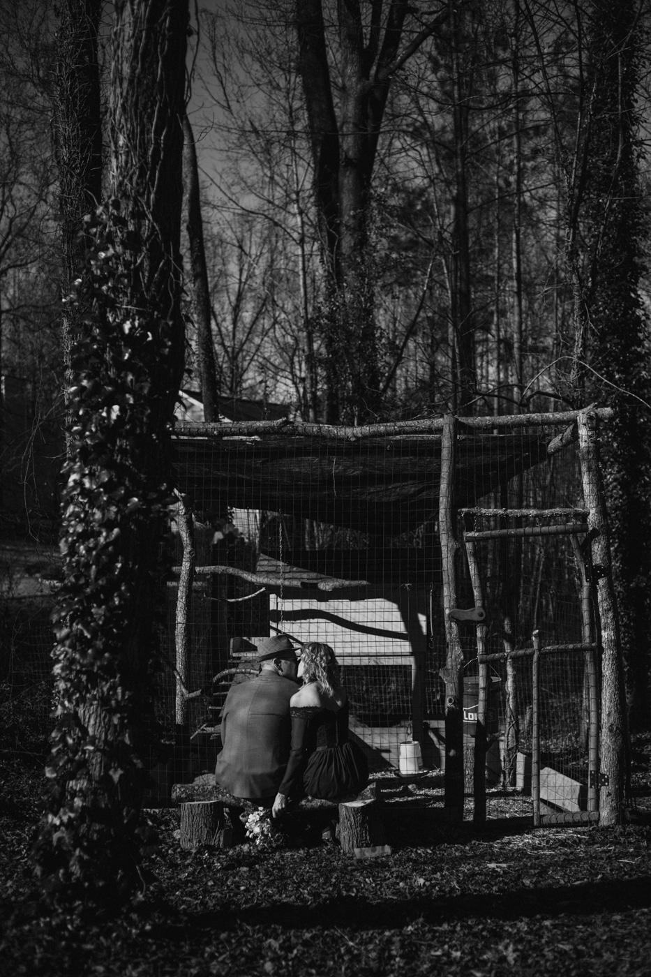 newlyweds pose by chicken coop in Atlanta GA