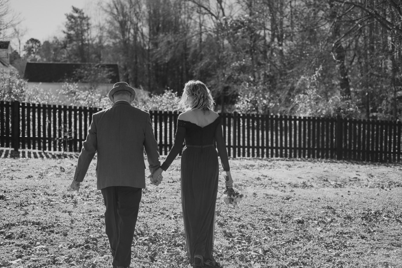 bride and groom walk around backyard during at-home elopement