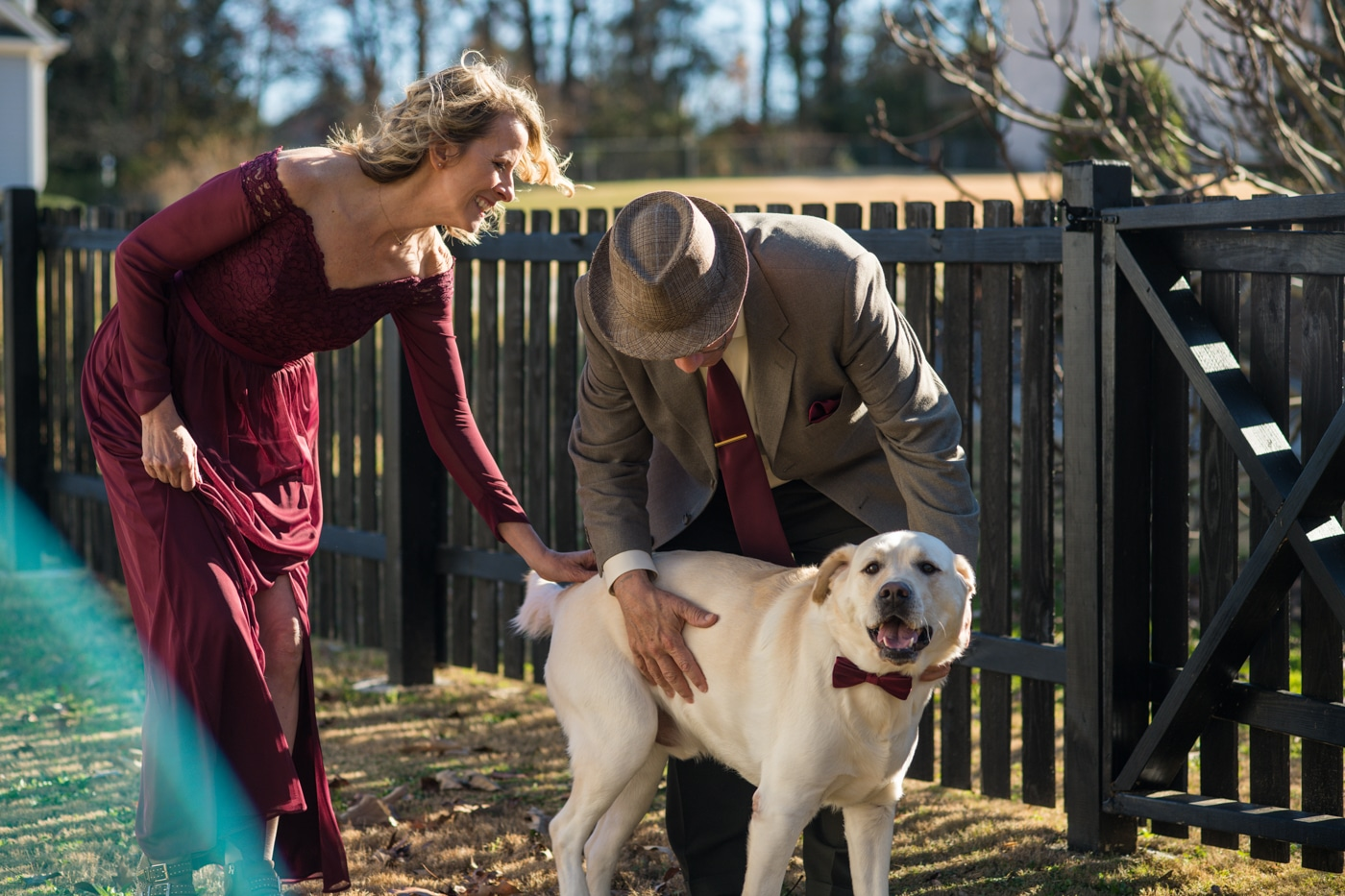 bride and groom pet dog during portraits after at-home elopement