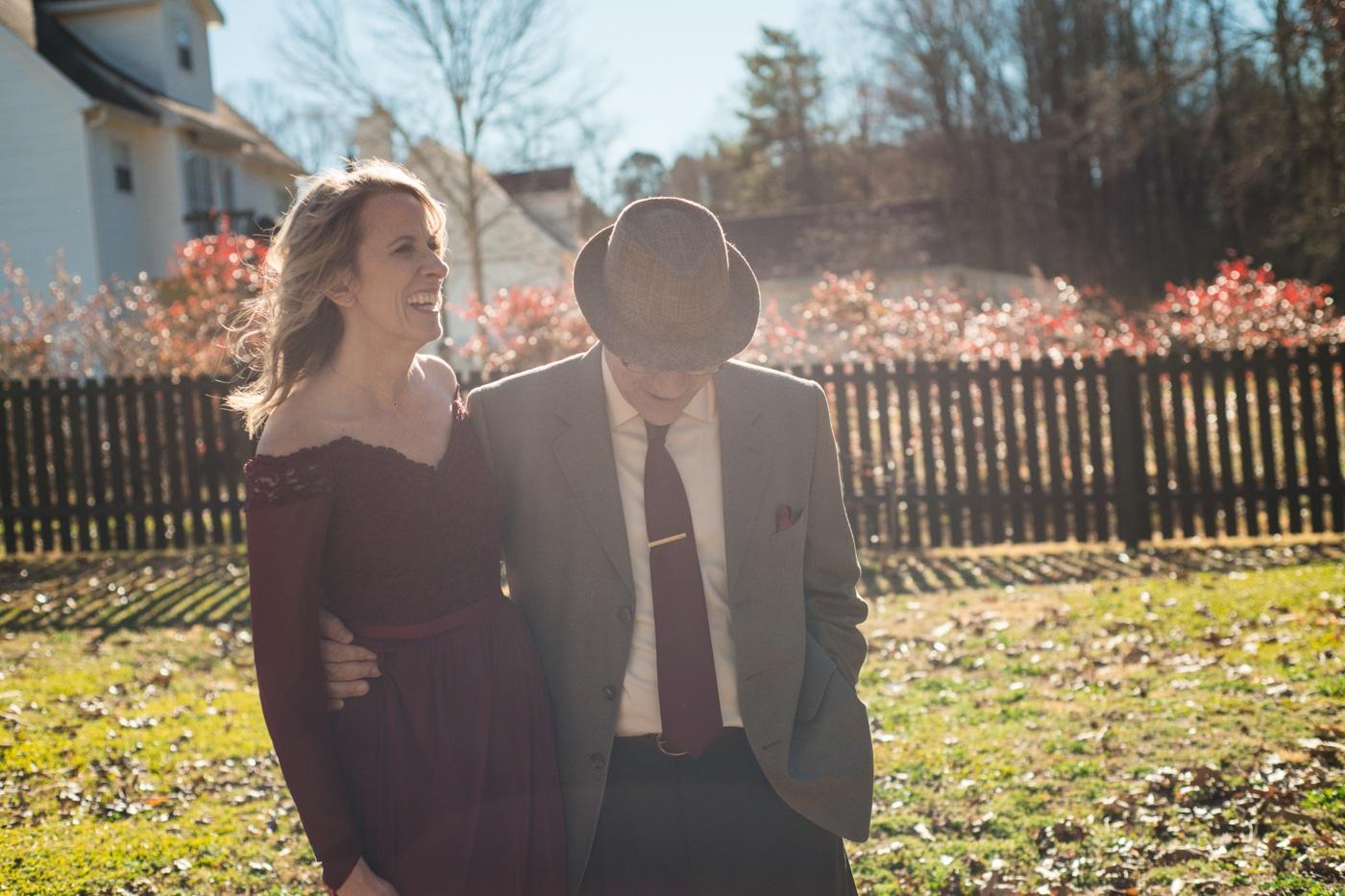 newlyweds laugh during ATL wedding photos