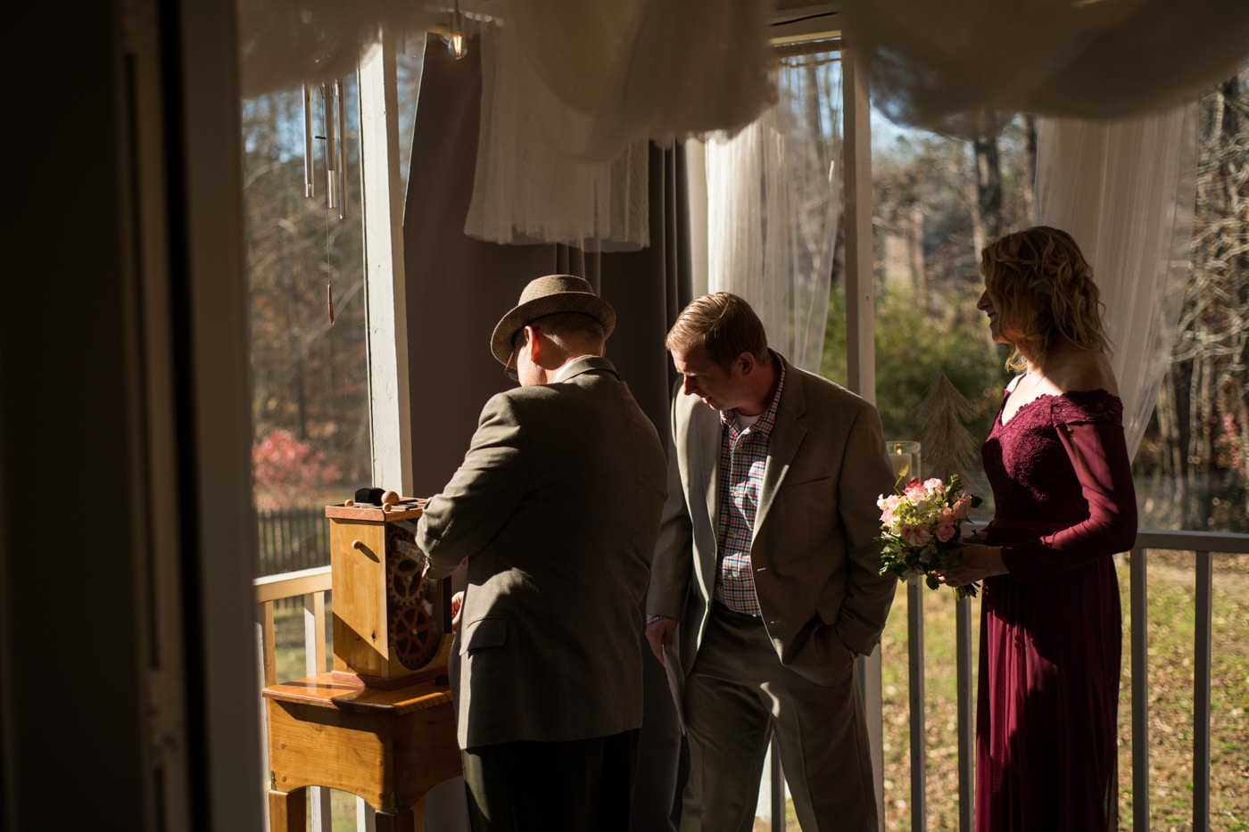 bride and groom meet at altar where groom shows off woodworking project