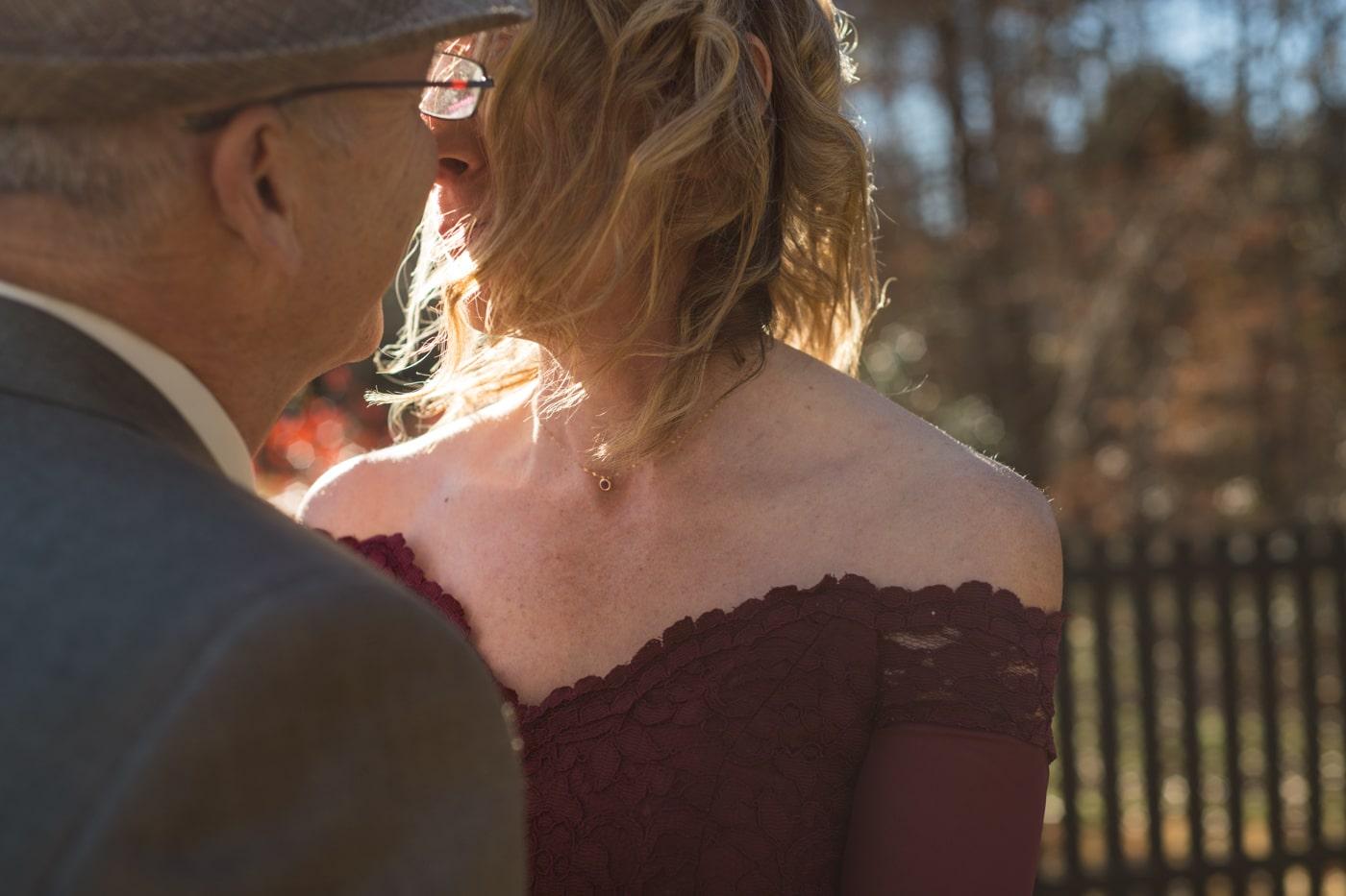newlyweds pose touching noses in backyard