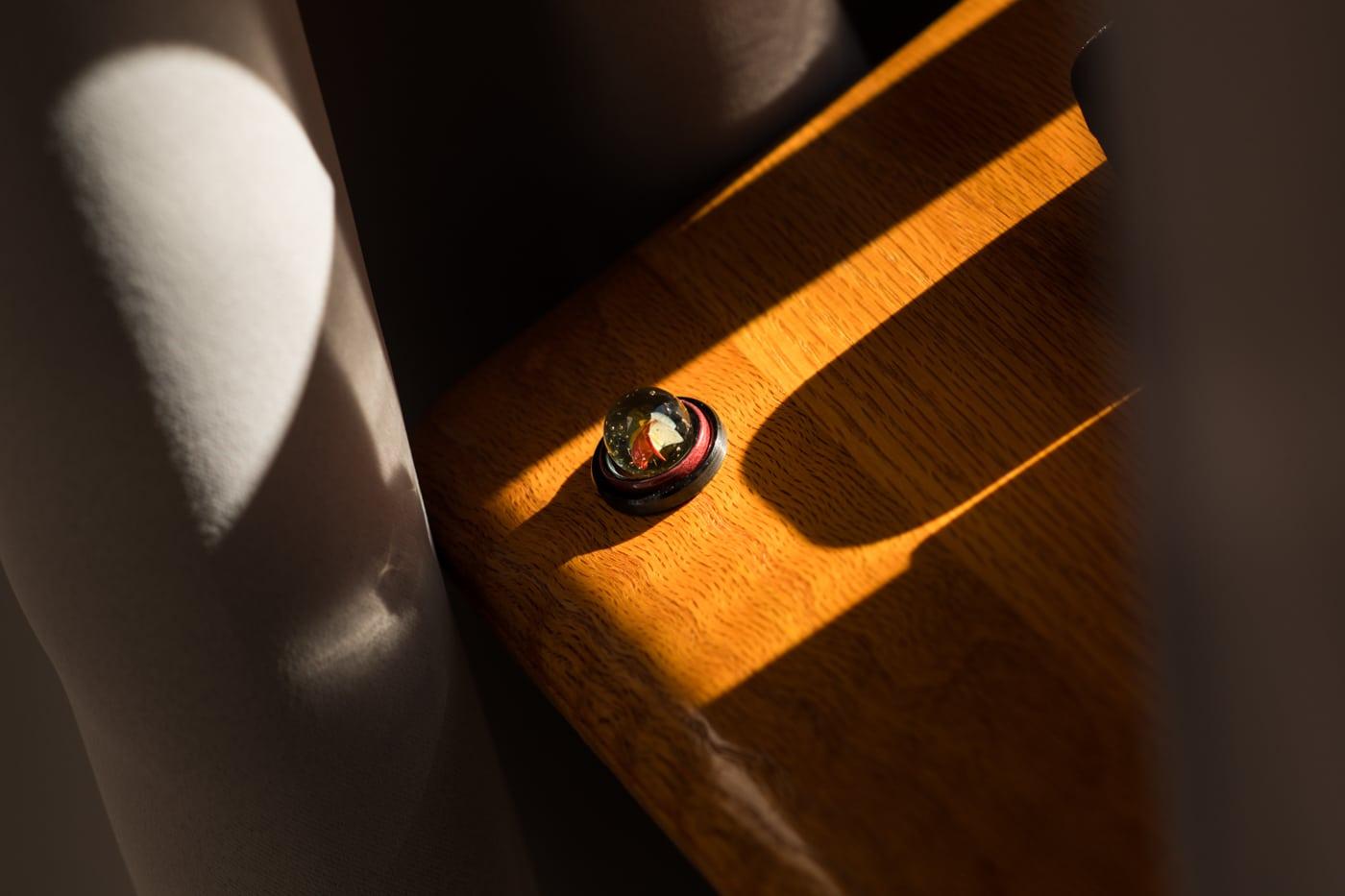 wedding rings rest on wood
