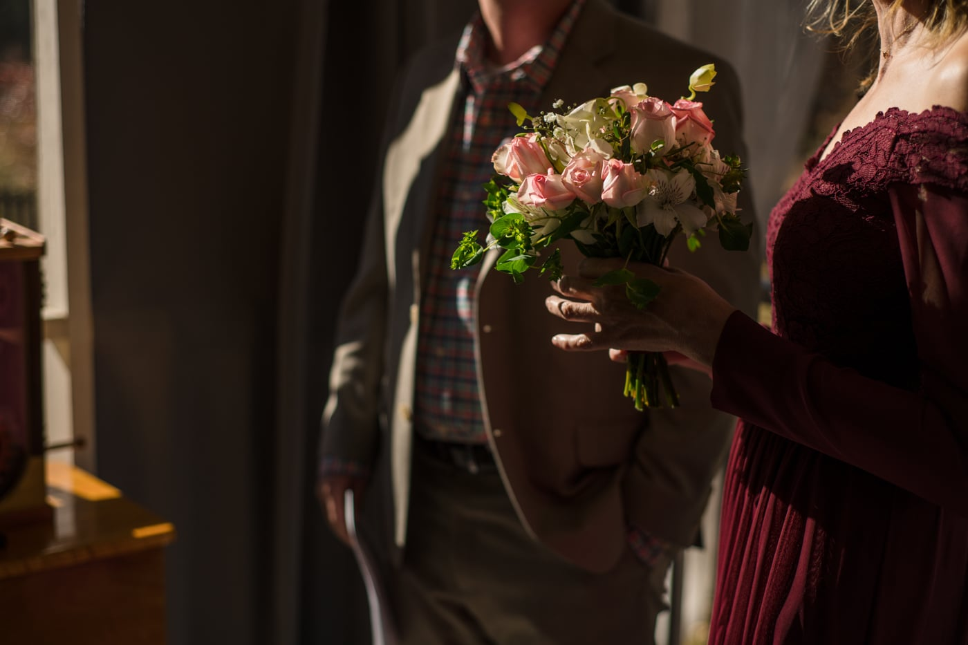 bride holds small bouquet during elopement at home in Atlanta