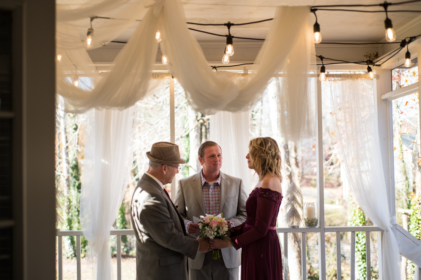 couple exchanges vows during ceremony at home