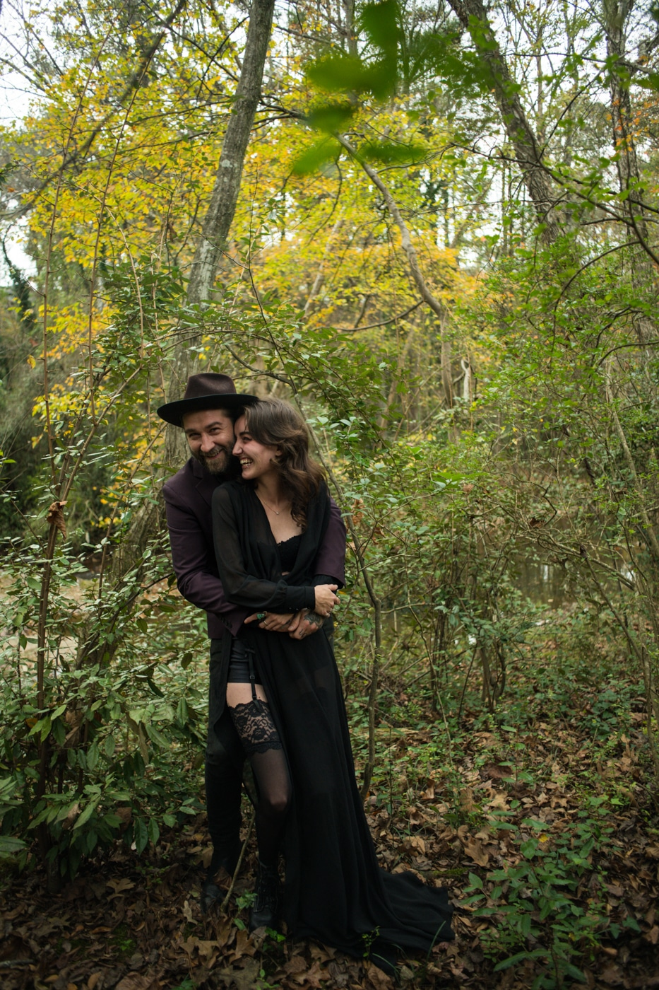 couple hugs during Backyard Witchy Portrait Session with Atlanta Wedding Photographer You Are Raven