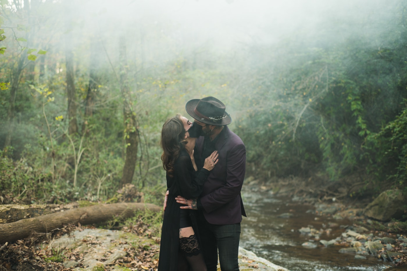 couple kisses with masks on during Backyard Witchy Portrait Session