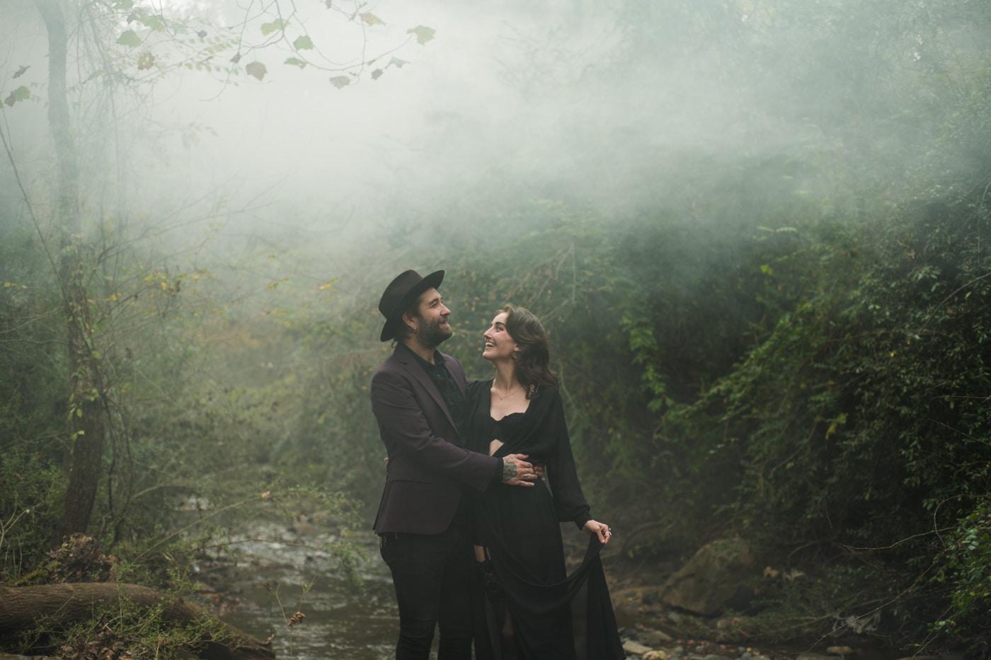 couple walks through backyard with smoke haze