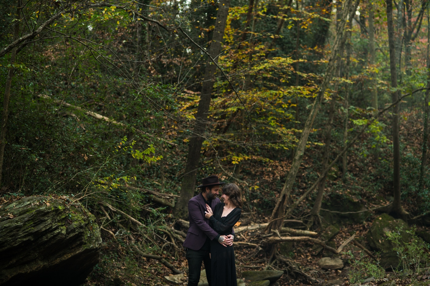 couple hugs in woods during portrait session in Atlanta