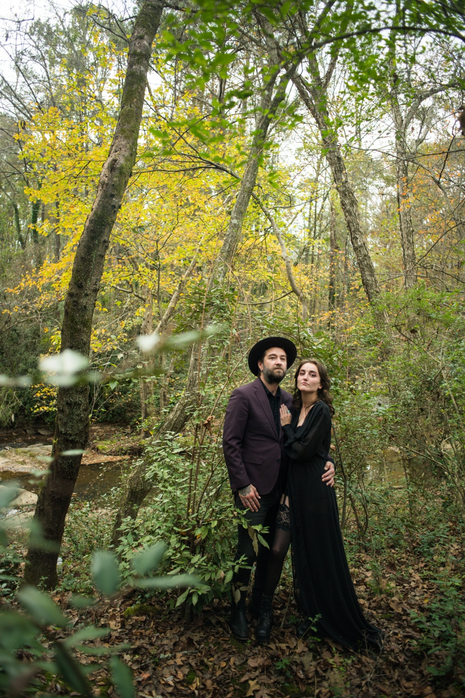 dramatic couples portraits in woods