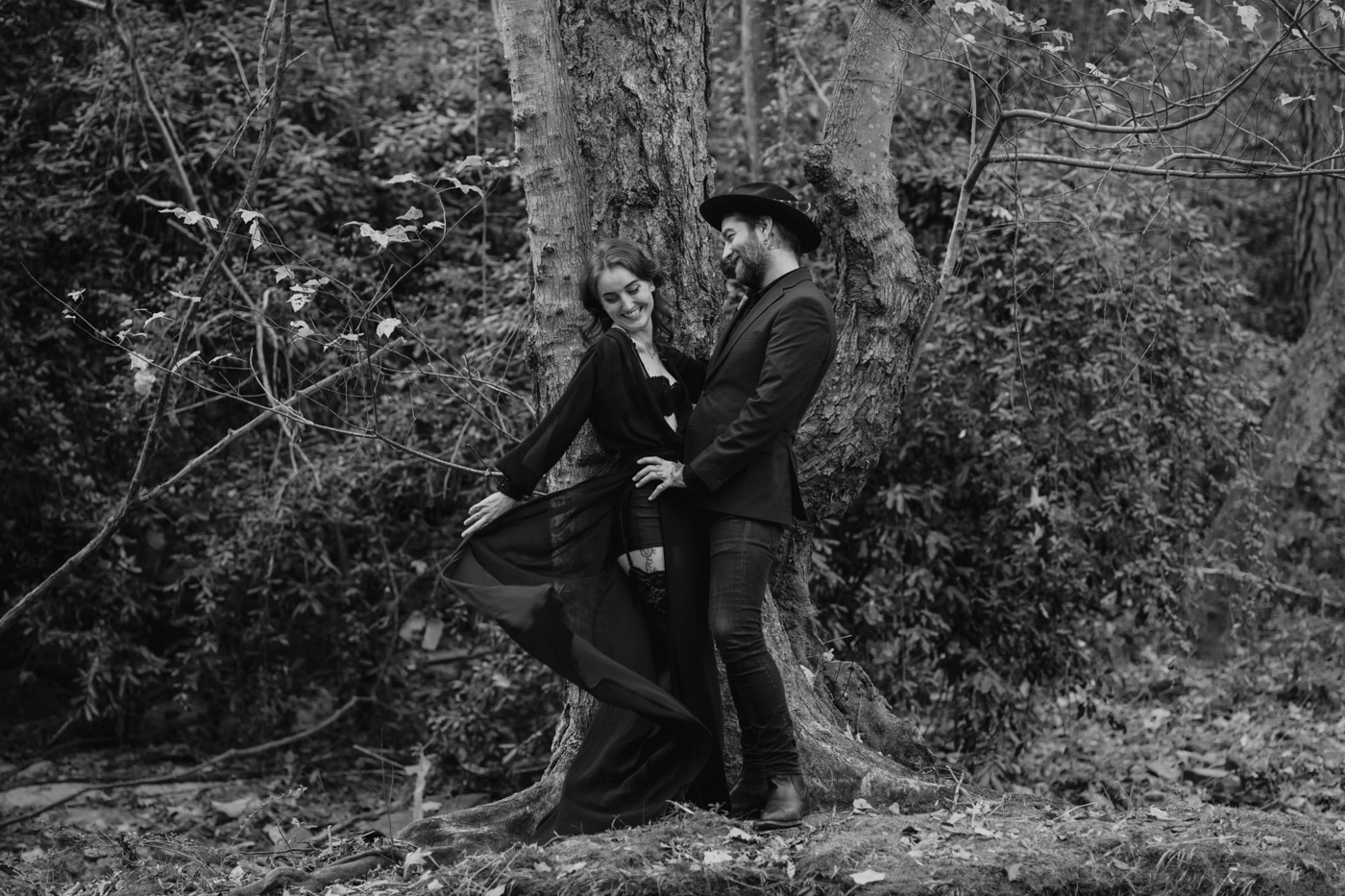couple dances during moody and edgy engagement portraits