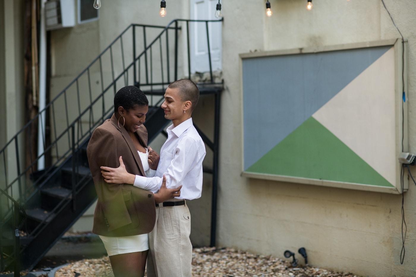 engaged couple hugs outside Westside Cultural Arts Center in Atlanta GA