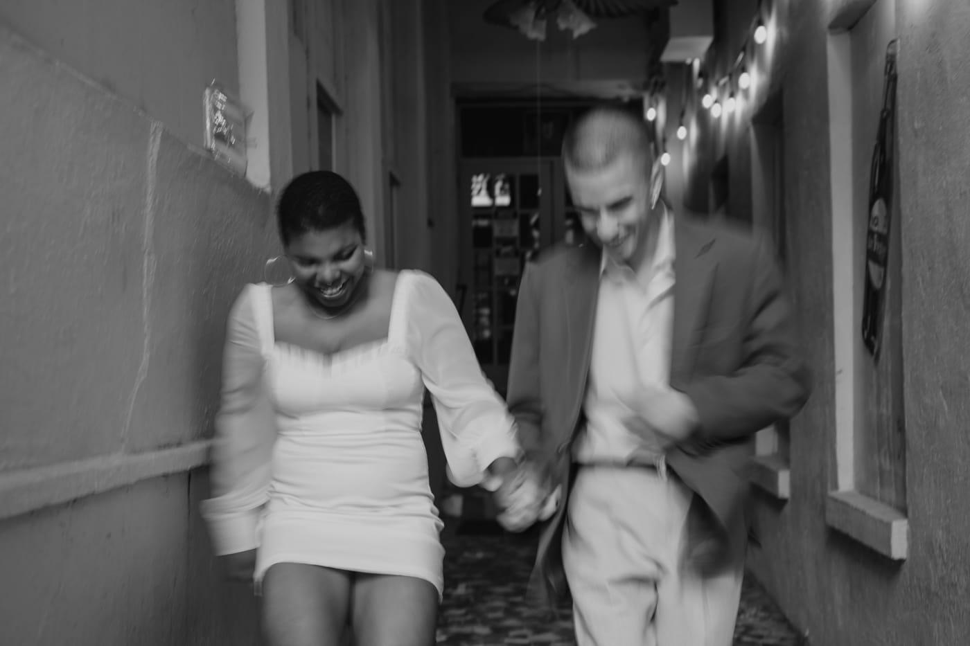 couple walks down hallway at Highland Inn