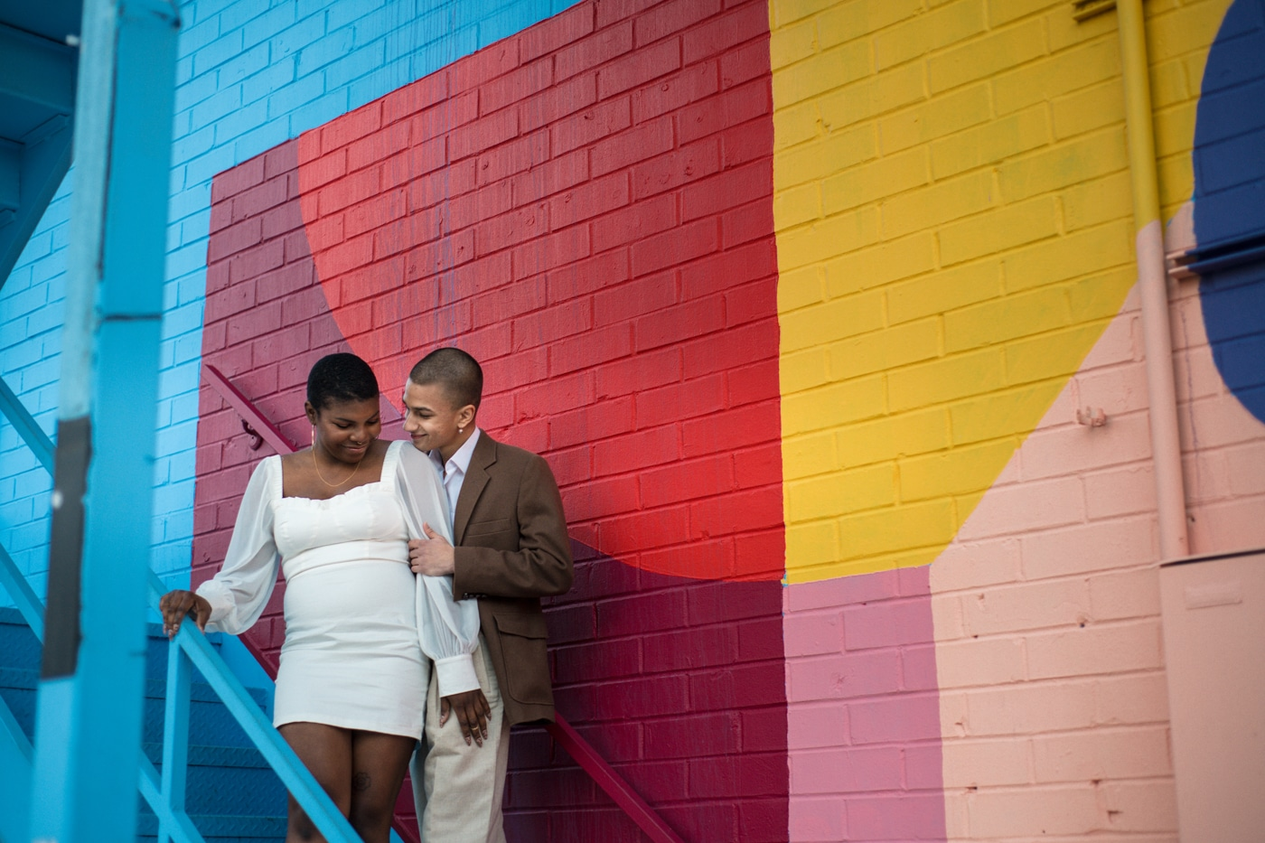 colorful Atlanta portrait session for couple by art mural