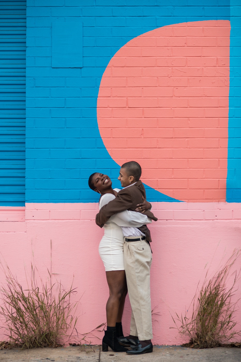 couple hugs and laughs during colorful Atlanta portrait session