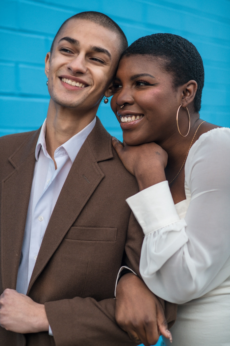 colorful Atlanta portrait session with couple by blue wall at Westside Cultural Arts Center