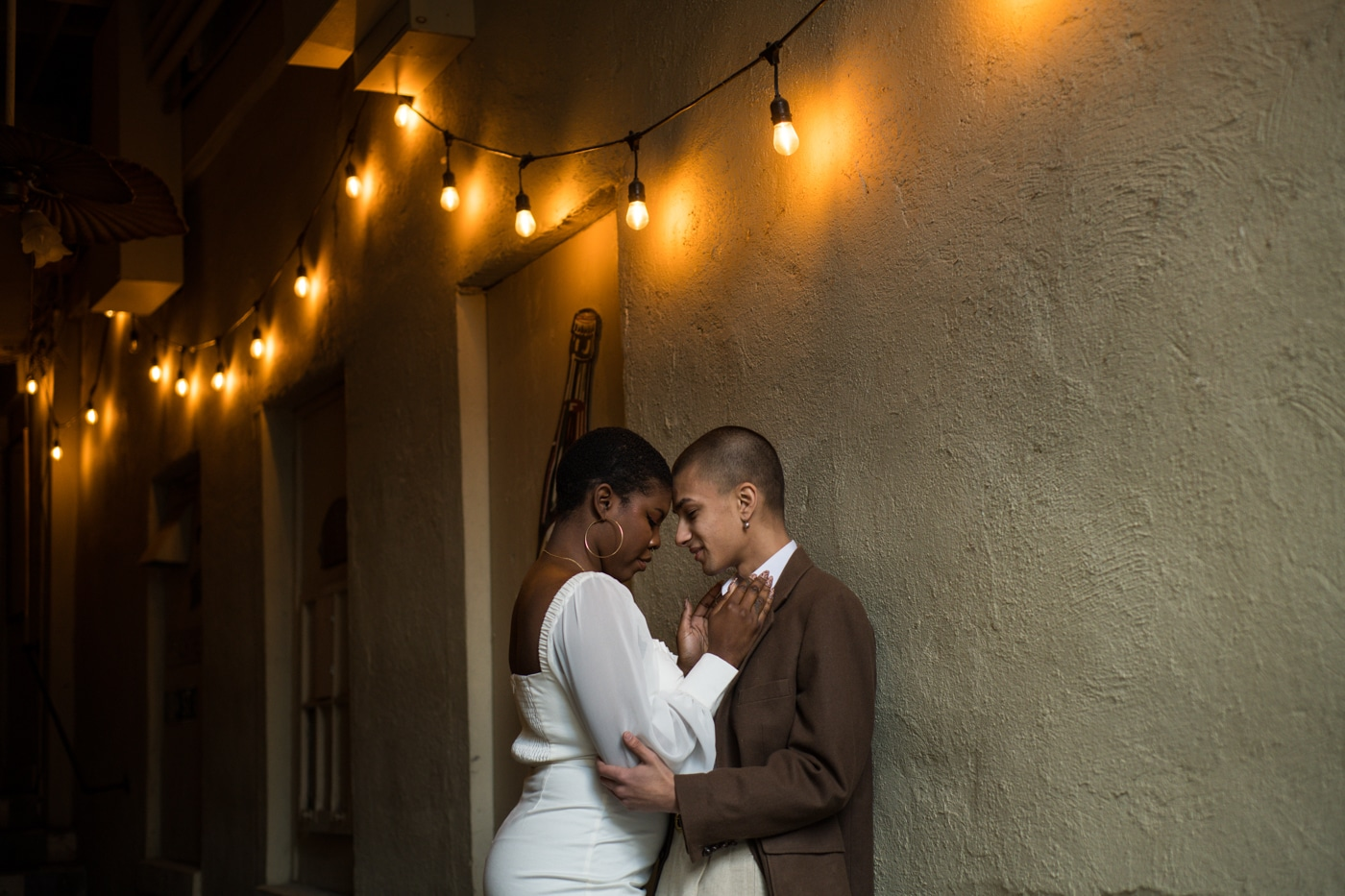 romantic engagement portraits under string lights in Atlanta