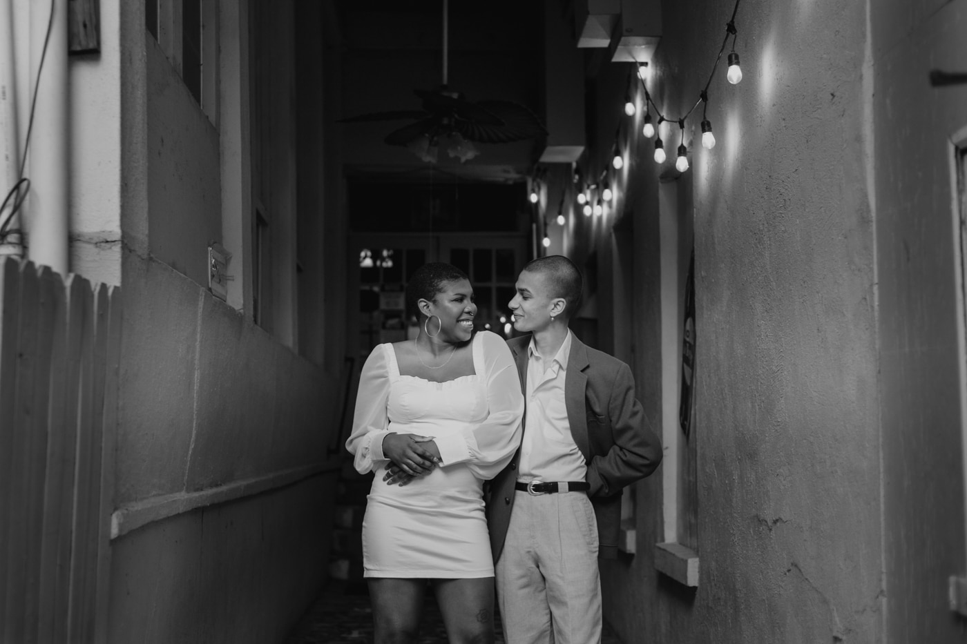 engaged couple dances in courtyard at highland Inn