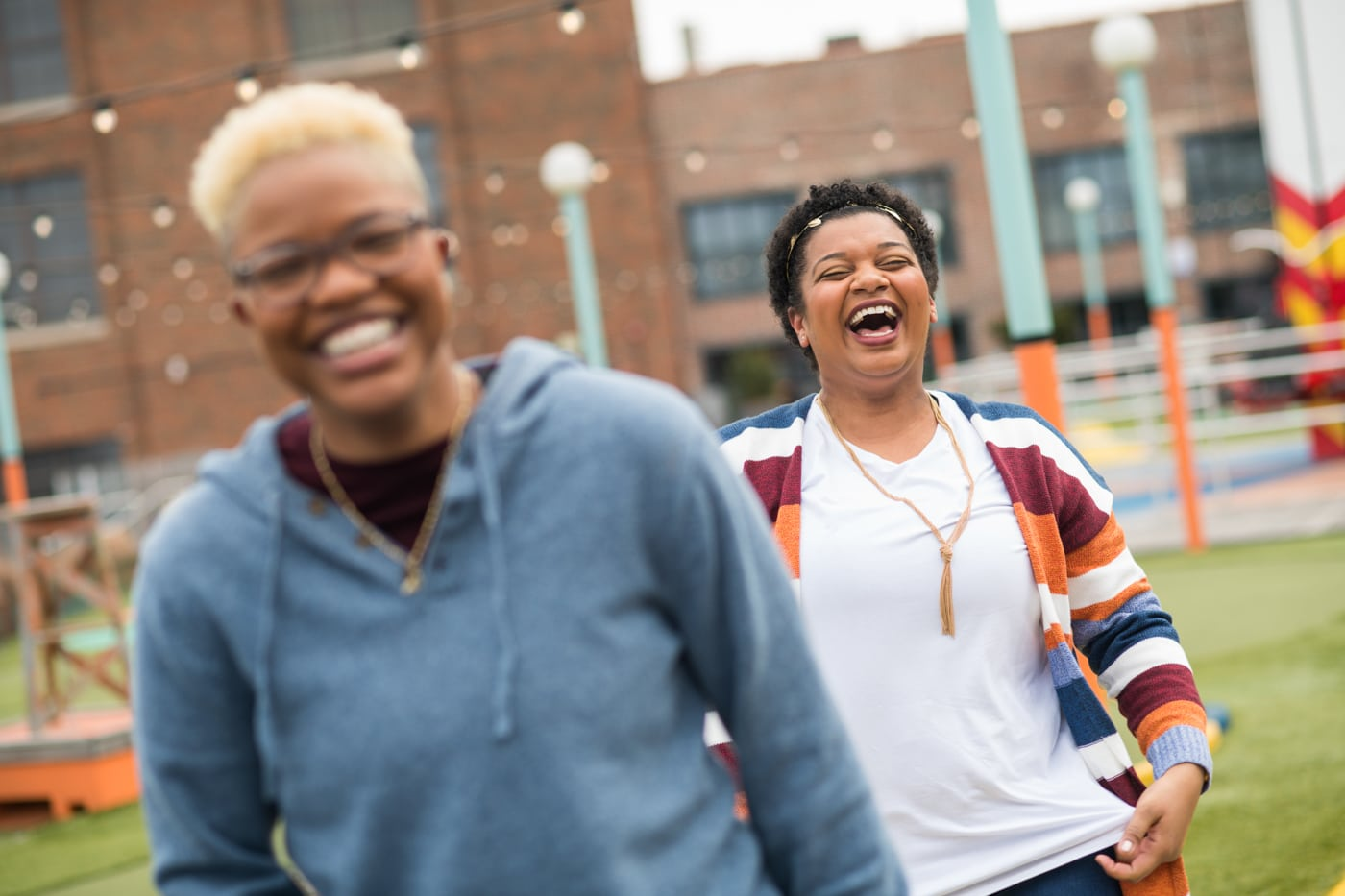 couple laughs together during Atlanta portrait session