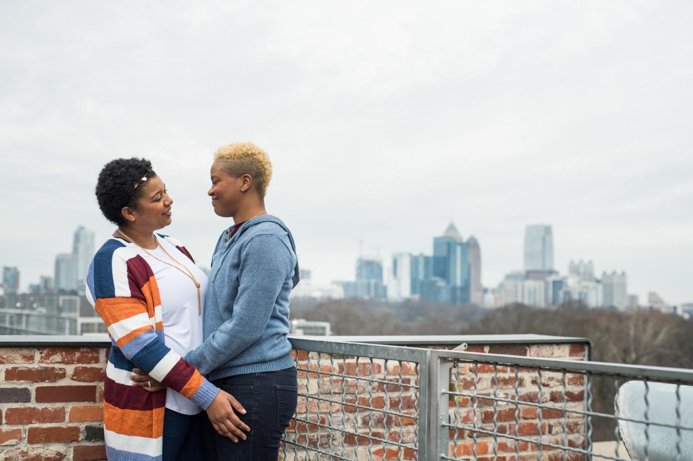 Atlanta couple hugs on rooftop at Ponce City Market