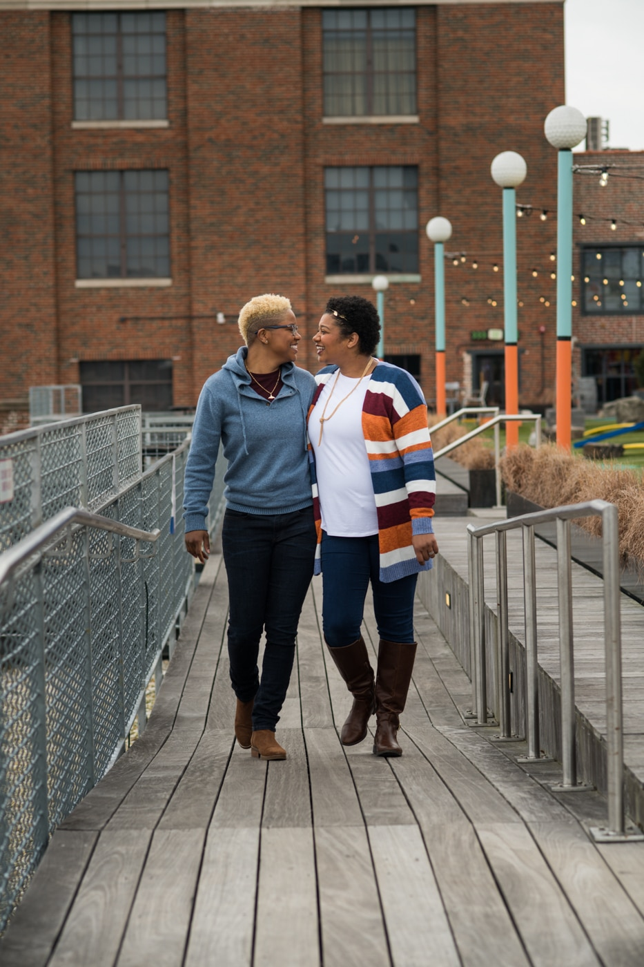 couple walks along wooden pathway at Ponce City Market