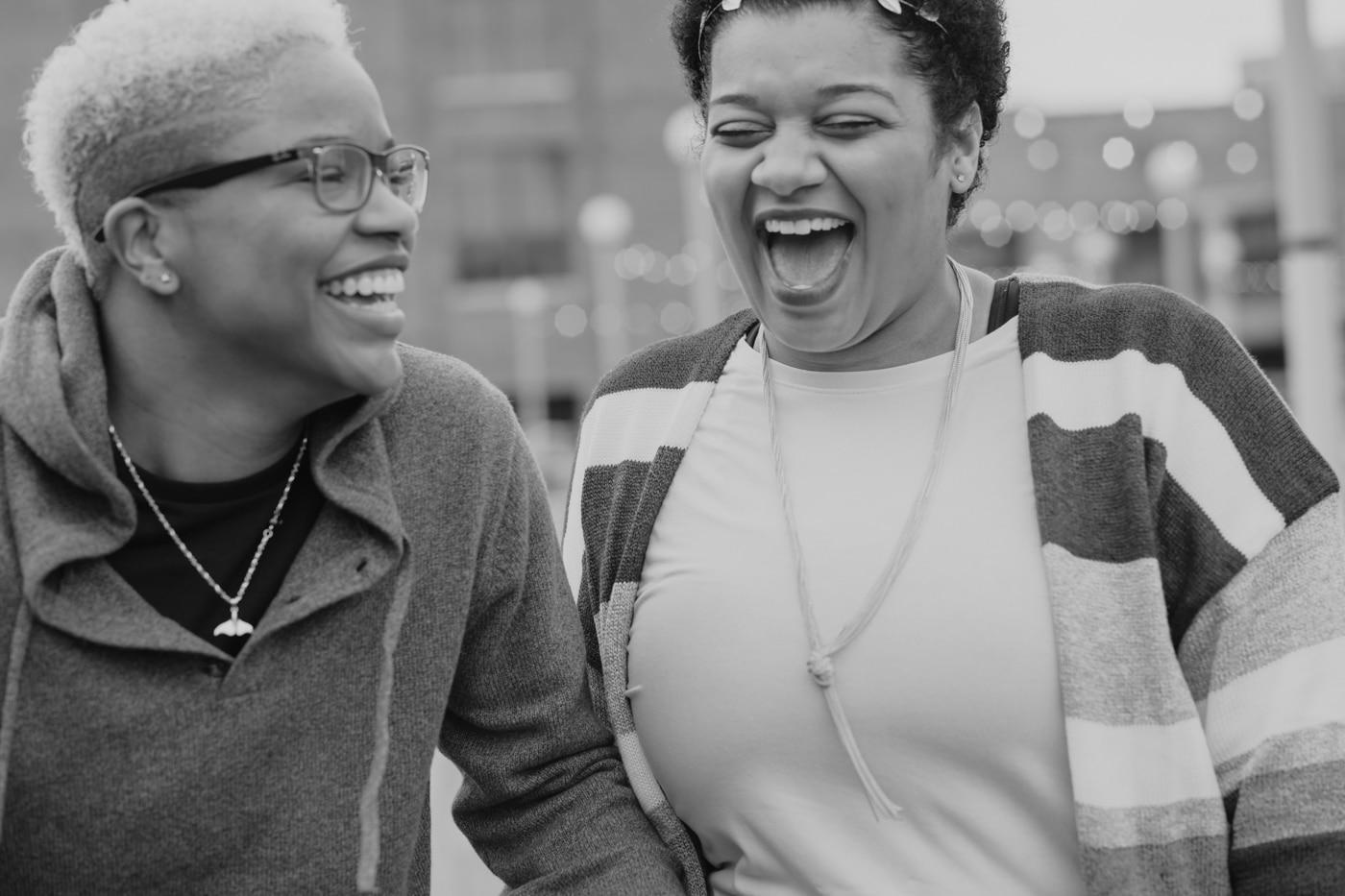 couple laughs during Atlanta portrait session