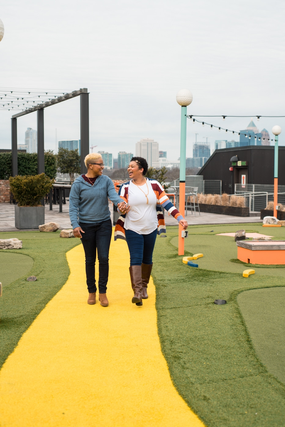couple walks through market in Ponce City