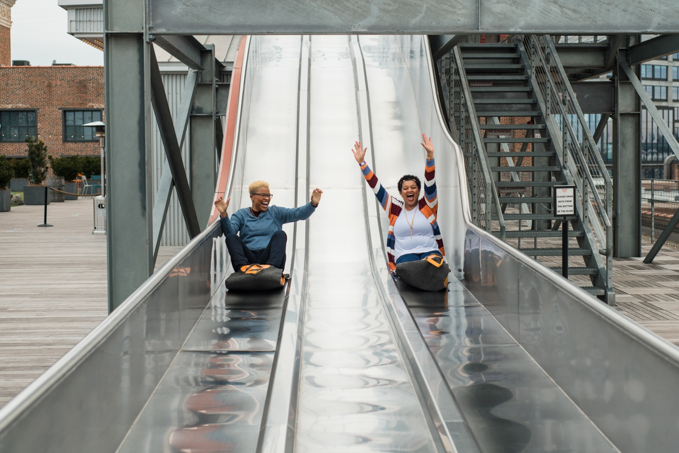 couple slides down metal slides in Atlanta