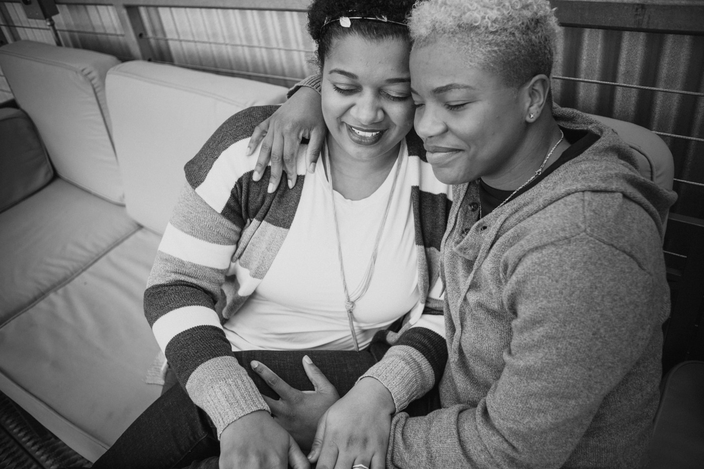 women cuddle on couch during Atlanta portraits