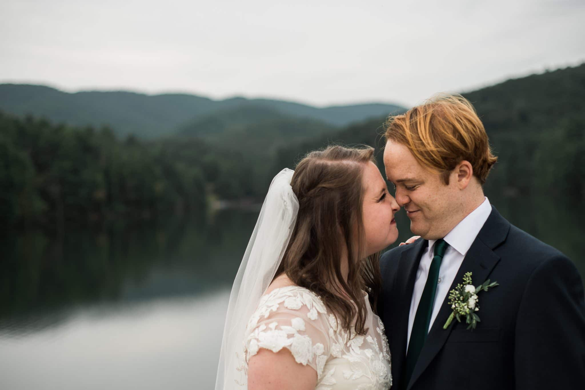 Georgia couple touches noses during portraits along the water in Georgia with You Are Raven