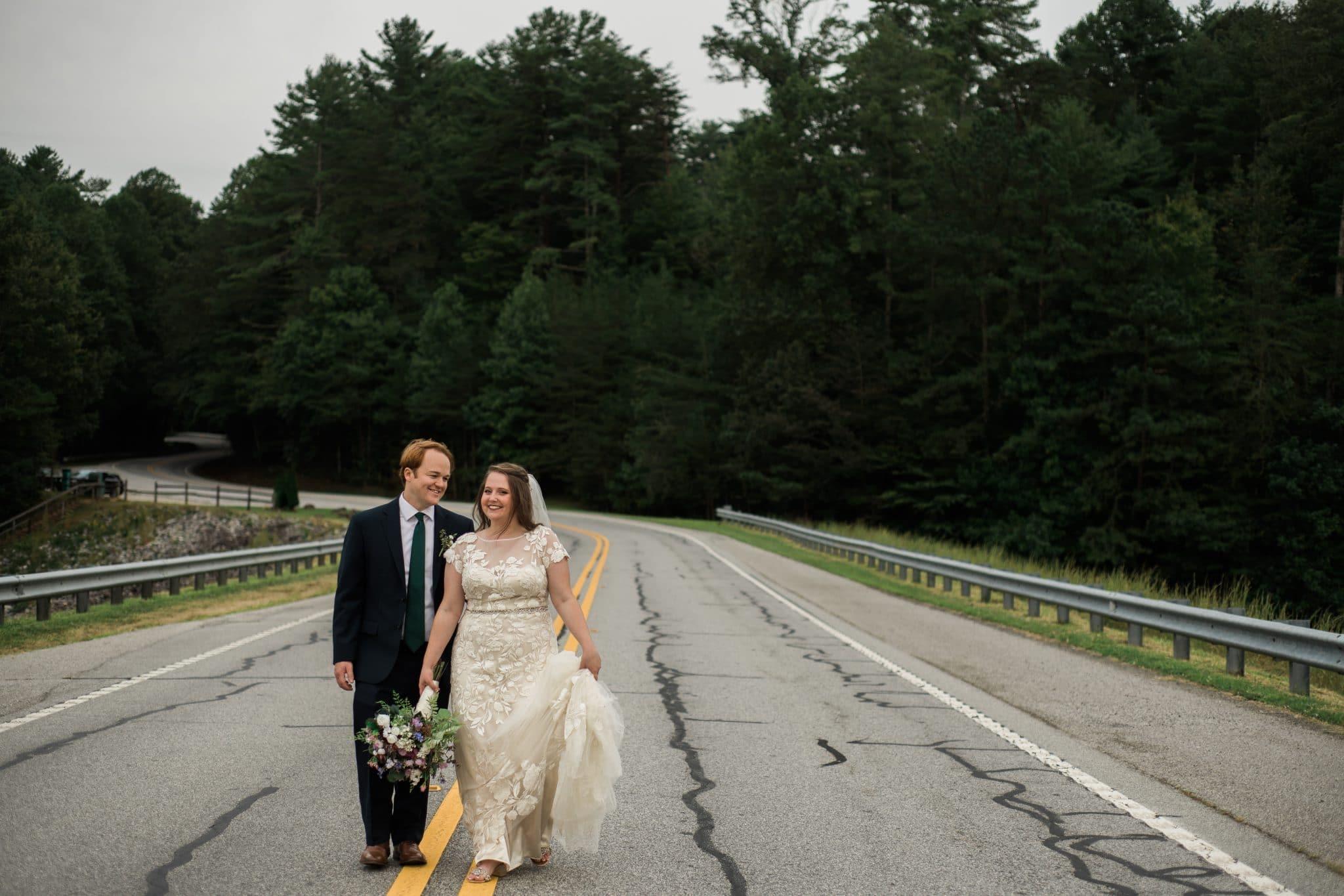 couple walks along street in Unicoi State Park