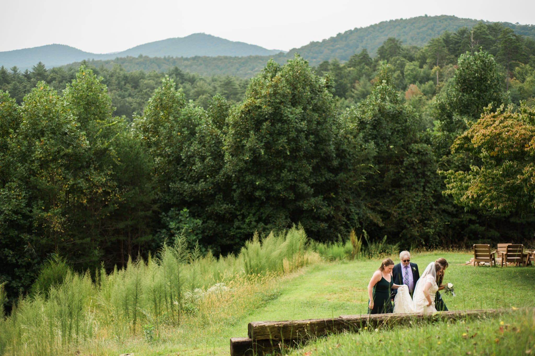 parents walk bride to first look with groom at Unicoi State Park