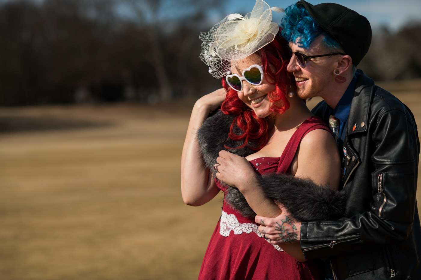 Alabama couple in vintage outfits pose in Piedmont Park with Raven Shutley Studios