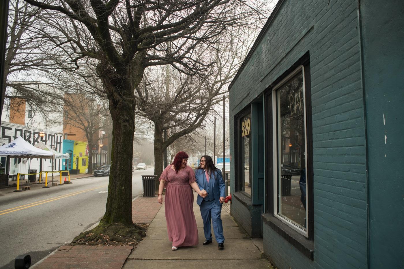 women walk through East Atlanta Village for portrait session