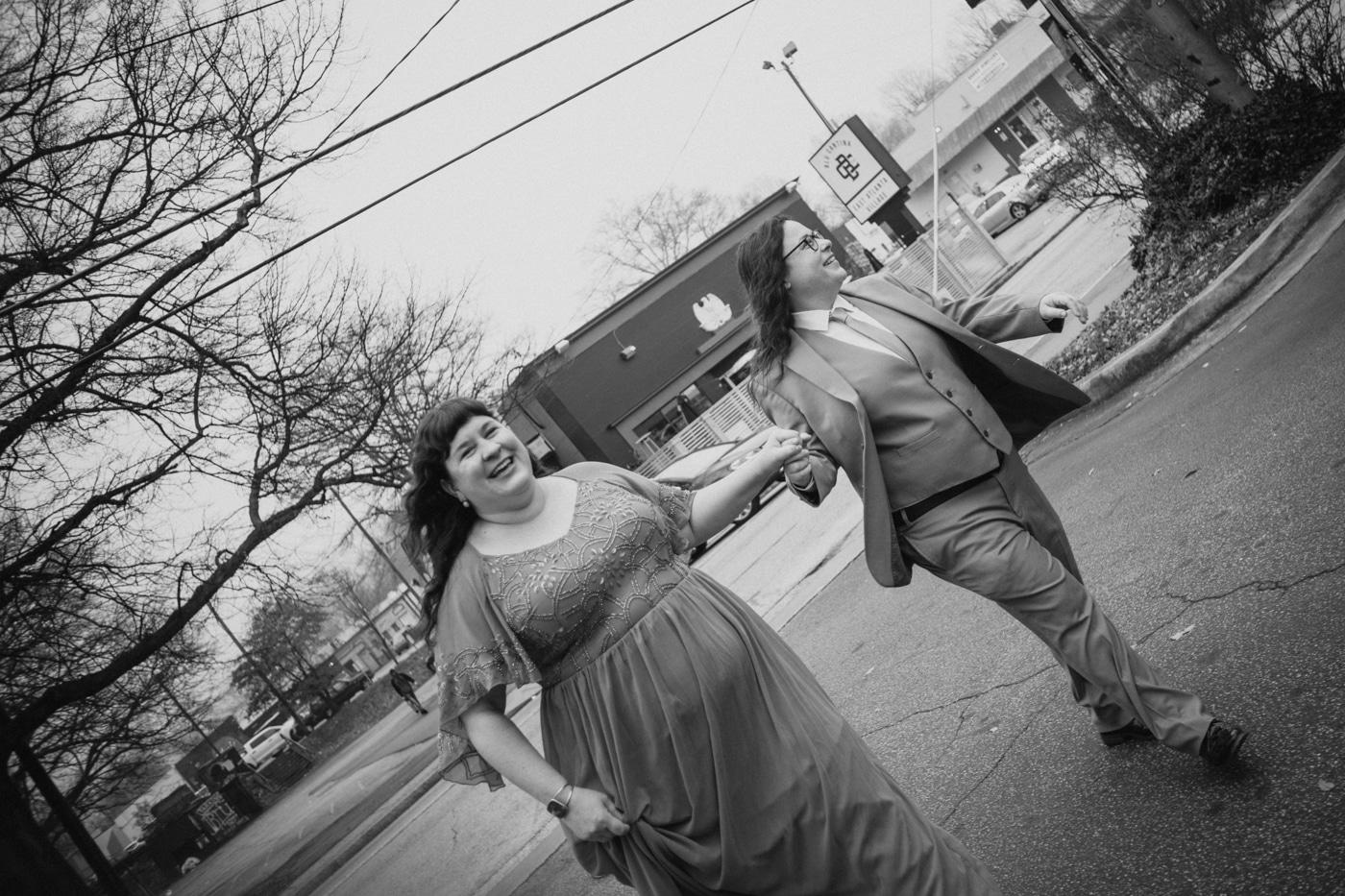 women hold hands walking through ATL with Raven Shutley Studios