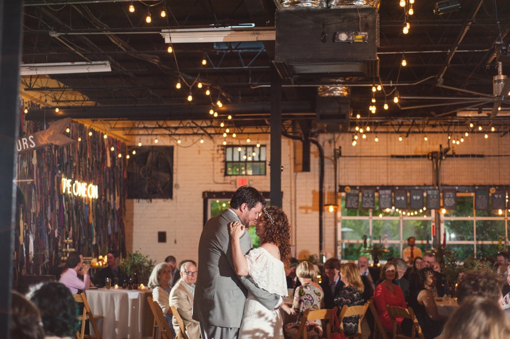 bride and groom dance during industrial reception at Monday Night Brewery