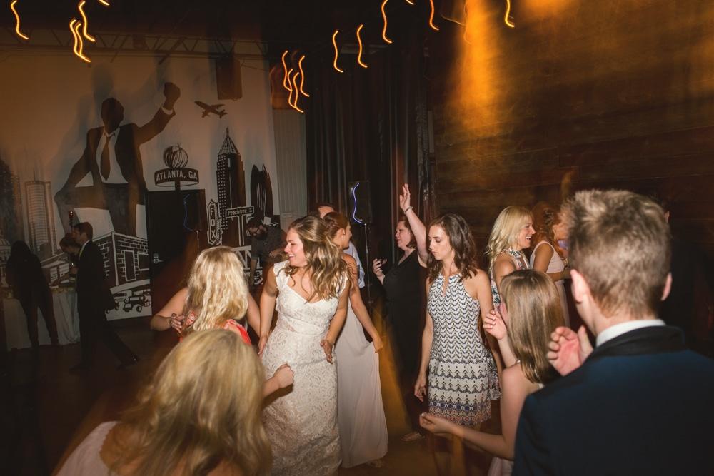 bride dances during Monday Night Brewery wedding reception