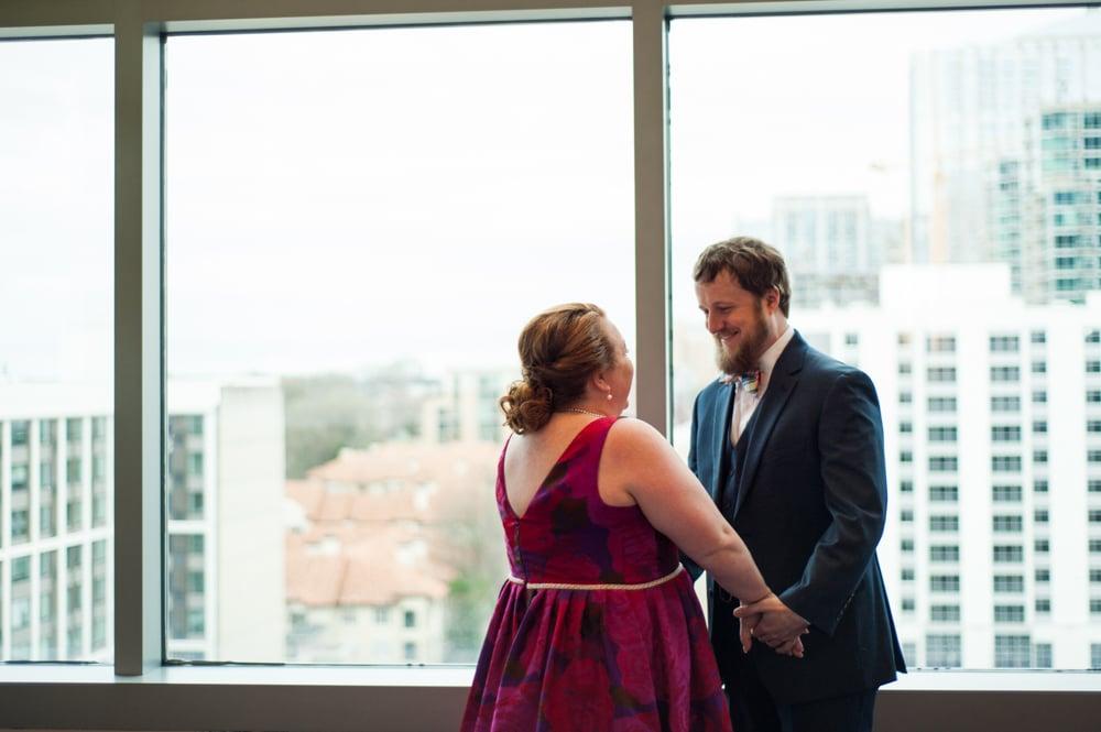 bride and groom have first look in Loewes Hotel in Atlanta