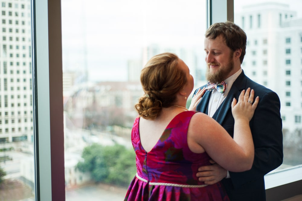 first look with bride in pink dress looking over Atlanta