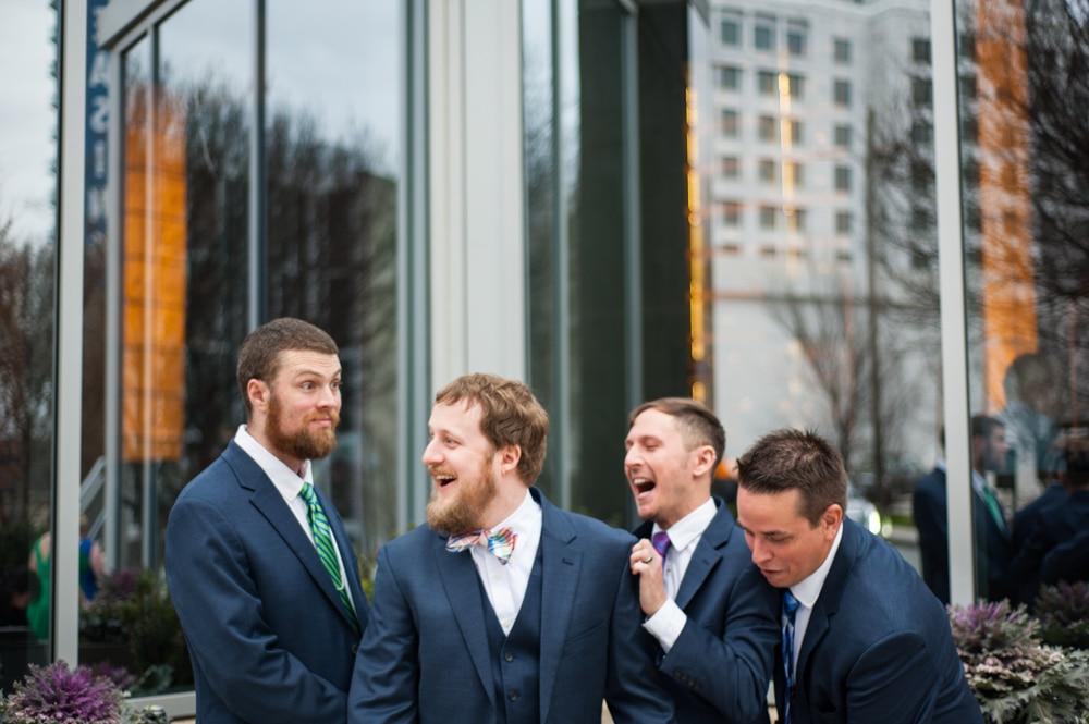 groomsmen laugh together during Monday Night Brewery wedding photos