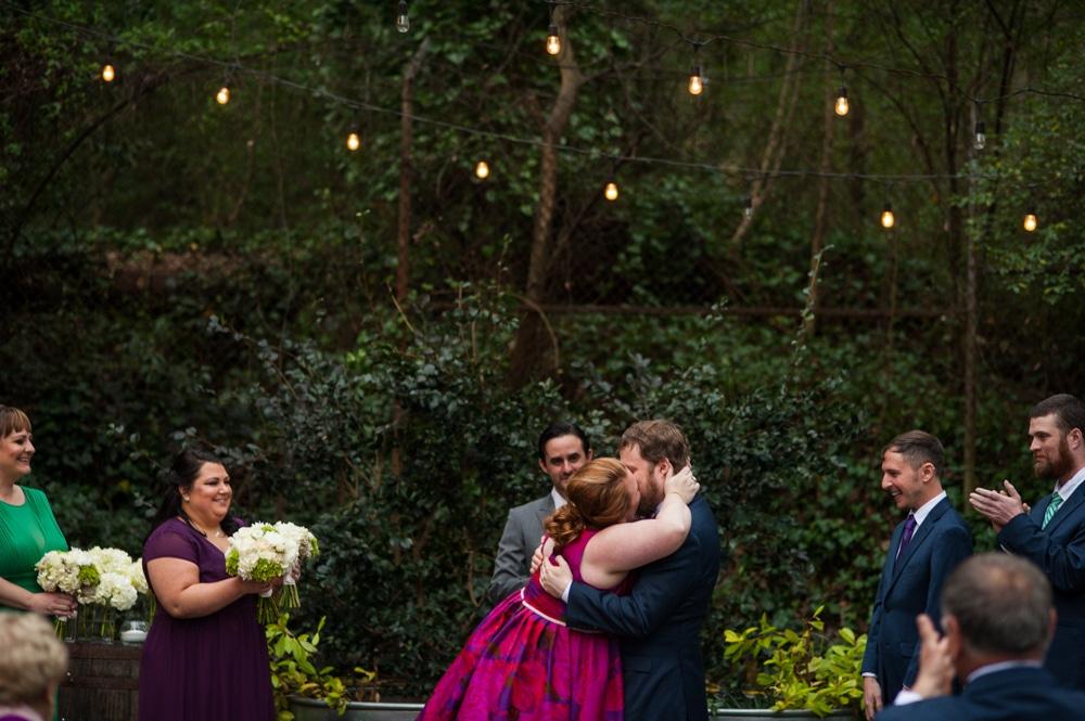 newlyweds kiss during Monday Night Brewery wedding ceremony