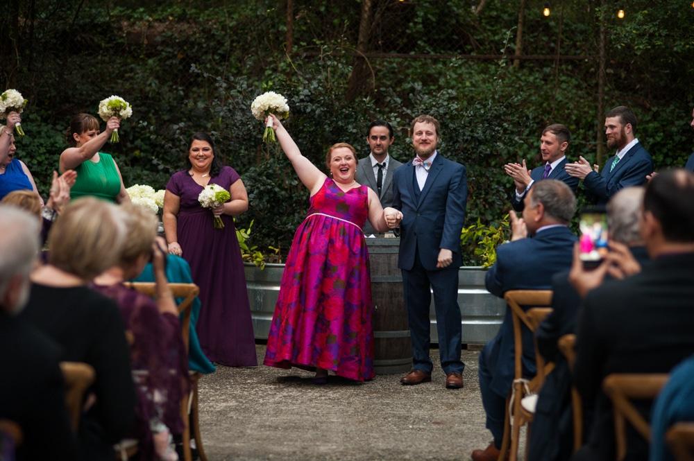 bride cheers during Monday Night Brewery wedding