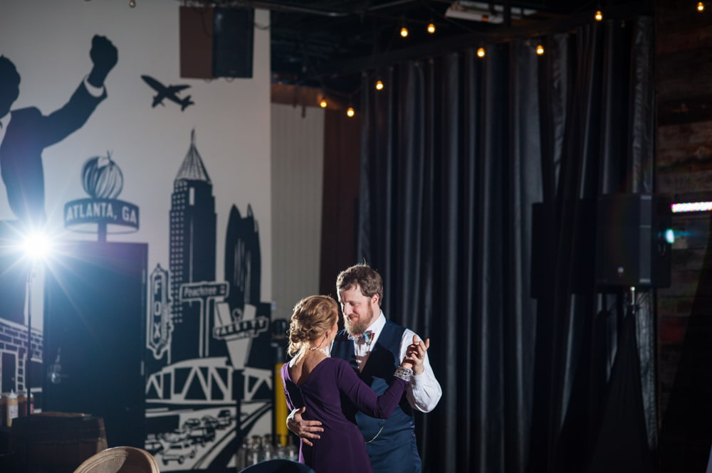 groom dances with mother at Monday Night Brewery wedding reception