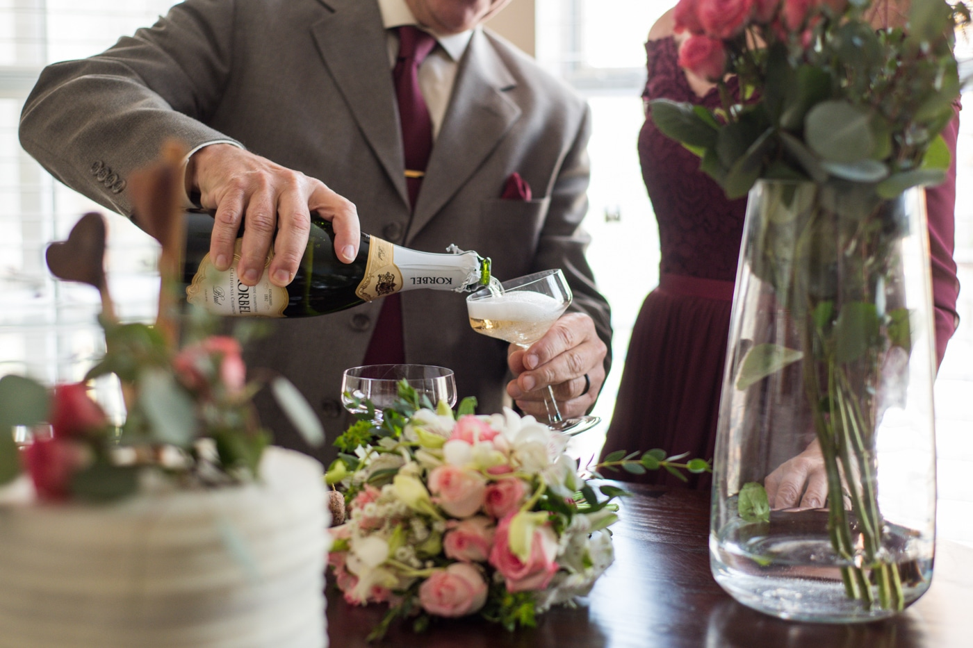 groom pours champagne for Atlanta wedding reception